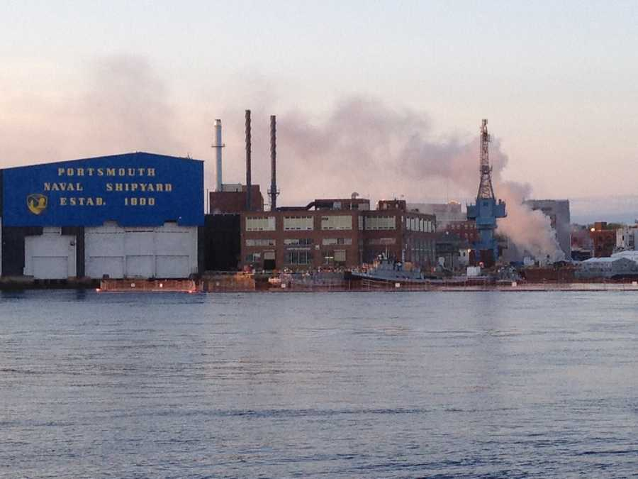 A fire on a nuclear-powered submarine at Portsmouth Naval Shipyard has injured four people.