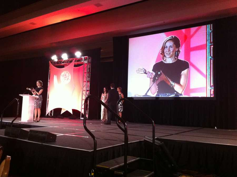 NewsCenter 5 Executive Editor Jen Berryman accepts the EMMY for Outstanding Writing.