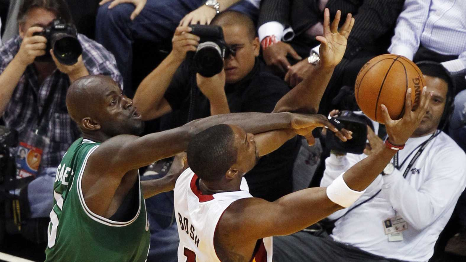 Miami Heat's Chris Bosh is fouled by Kevin Garnett during the first half of Game 5.
