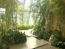 A private elevator stops at the penthouse's lush Bamboo Garden.