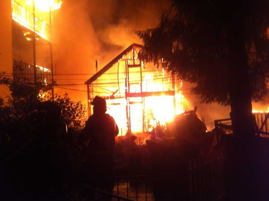 Firefighters battled heavy flames at the height of Tuesday's 4-alarm fire