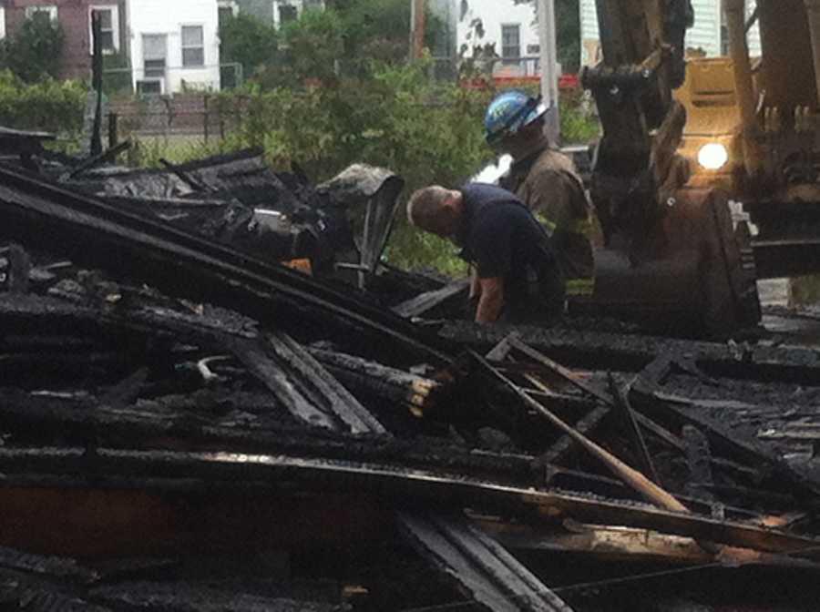 Firefighters survey damage on Merrick Street
