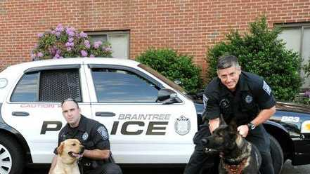 Braintree police officers with their dogs: Richard Seibert and Lucky and Tom Flannery and Czar.