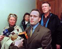 Casey Sherman, center-foreground, nephew of Mary Sullivan, the alleged last victim of Boston Strangler suspect Albert DeSalvo, talks with reporters Wednesday, Feb. 28, 2001 in Cambridge, following a federal judge's ruling to allow the family members of Sullivan and DeSalvo to proceed with a lawsuit for the release of evidence in the notorious case.