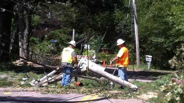 Crews working in Foxborough after Tropical Storm Irene knocked out power.