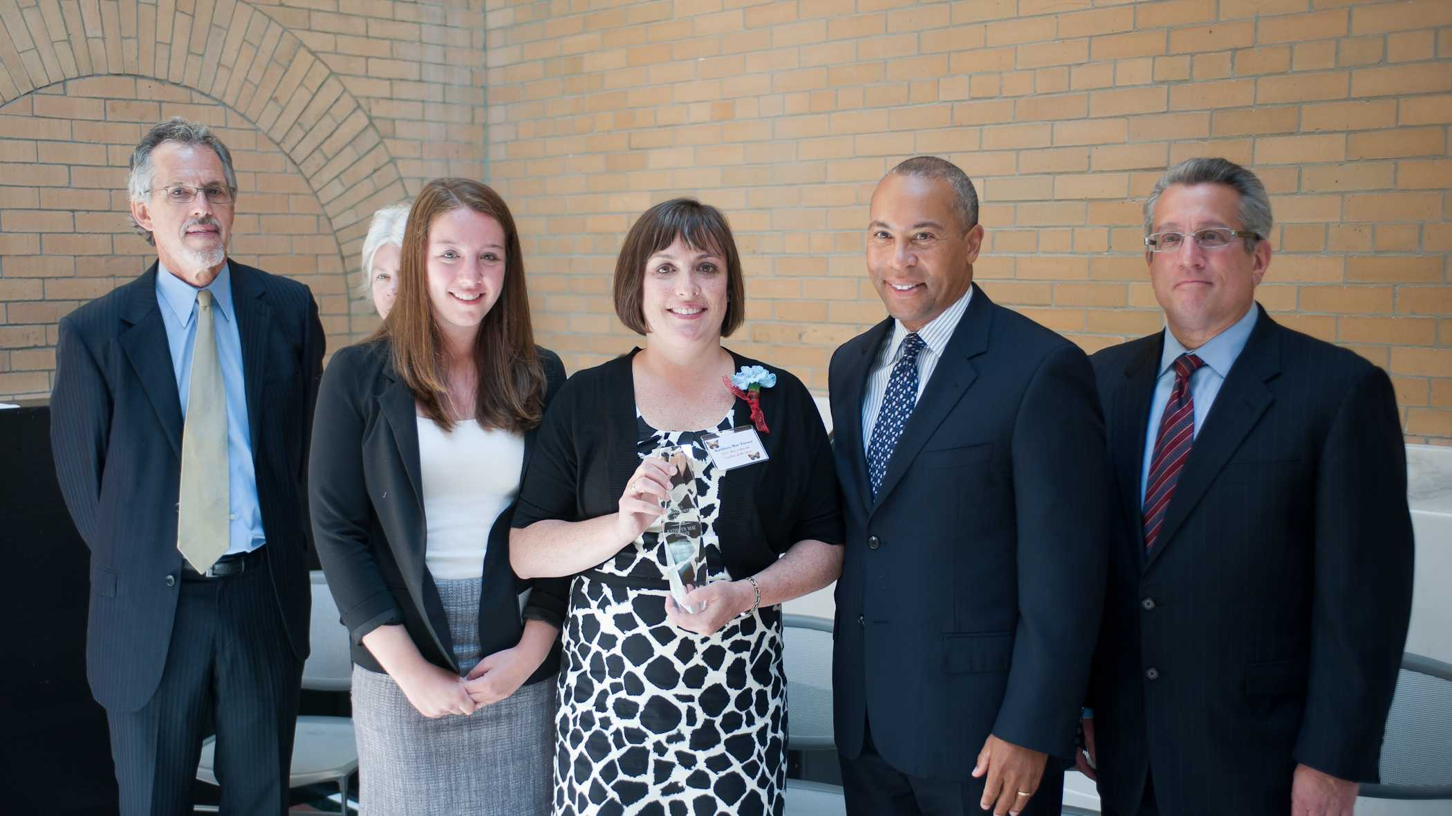 Governor Patrick congratulates 2013 Teacher of the Year Kathleen Mae Turner of Sharon High School. From left: Paul Reville, Secretary of Education&#x3B; Alex Stoller, former student of Ms. Turner&#x3B; Ms. Turner, 2013 Teacher of the Year&#x3B; Governor Patrick&#x3B; and Mitchel Chester, Commissioner of the Department of Elementary and Secondary Education.