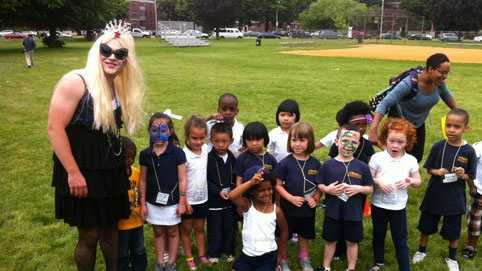 Principal Justin Vernon, dressed as Lady Gaga, poses with students from the Roger Clap Innovation School.
