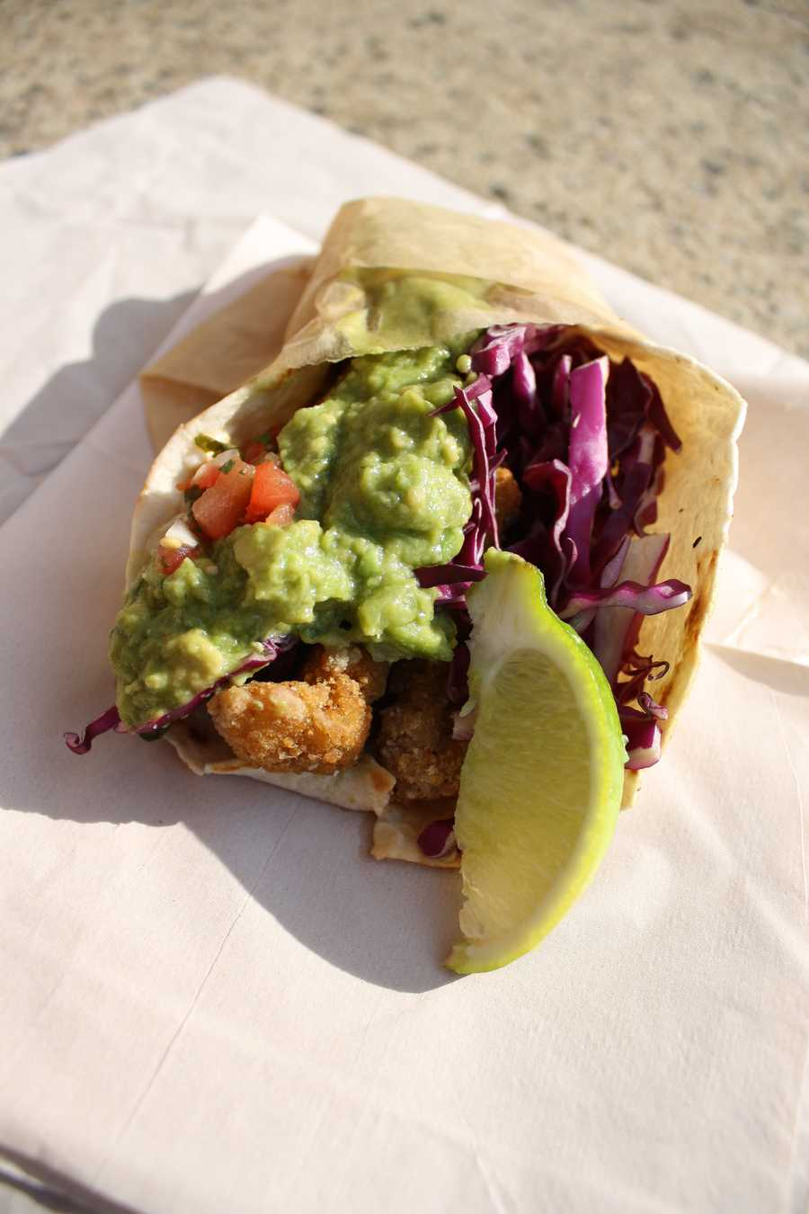The pescado taco (crispy catfish w/ red cabbage, pico de gallo, Mexican tartar sauce, and chipotle salsa)