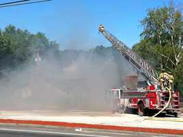 """""""He (the tractor trailer driver) slid along the ground and took out the gas main and the electrical lines. There was a pretty good explosion and it started a fire,"""" Gregory Esmay, co-owner of the restaurant, told the Providence Journal."""