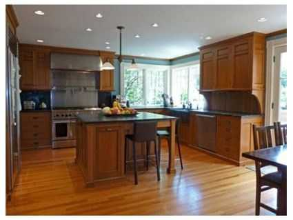 There is a large renovated chef's kitchen.