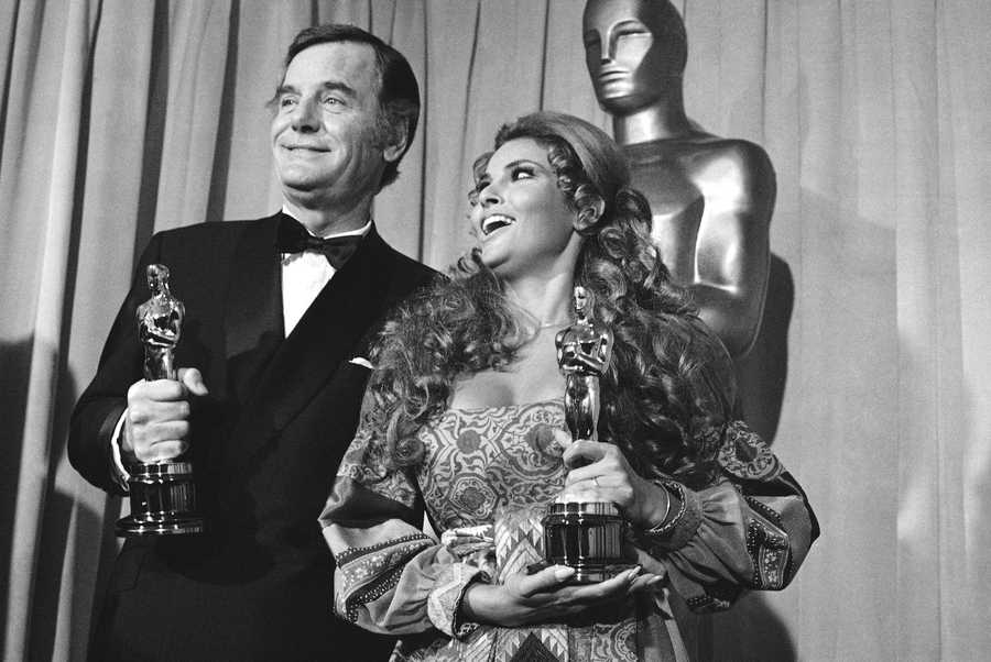 """Actor Gig Young (seen here with Raquel Welch) was an actor who won an Academy Award for his performance as a dance-marathon emcee in the 1969 film """"They Shoot Horses, Don't They?""""Police believe that Young shot his wife, Kim Schmidt, and then turned the gun on himself in a murder-suicide.(November 4, 1913 – October 19, 1978)"""