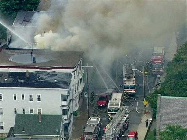 Crews are battling a 2-alarm blaze that broke out in a pair of triple-deckers in Lawrence on Thursday.