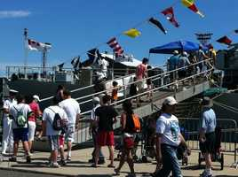 A steady crowd arriving to view the U.S.S. Eagle.