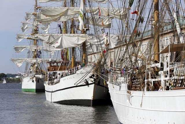 Tall ships, from right, Cisne Branco, from Brazil, Guayas, from Ecuador and Gloria, from Colombia, are seen docked at the Fish Pier in Boston, 2012.