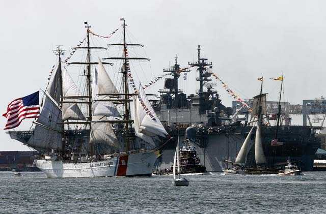 The US Coast Guard ship The Eagle, left, sails past the USS Wasp on its way to dock at the Charlestown Navy Yard in Boston.