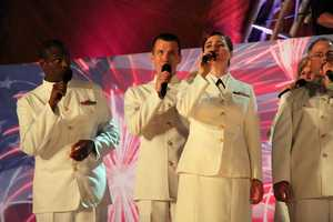 The U.S. Navy Sea Chanters added their voices to the 1812 Overture.