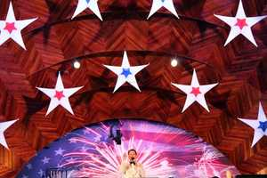 Boston Pops conductor Keith Lockhart amid a sea of stars on stage.