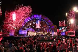 """Confetti begins to rain down as """"The Stars and Stripes Forever"""" concludes the rehearsal concert."""