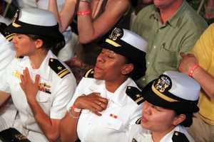 Sailors react during the patriotic sing-along.