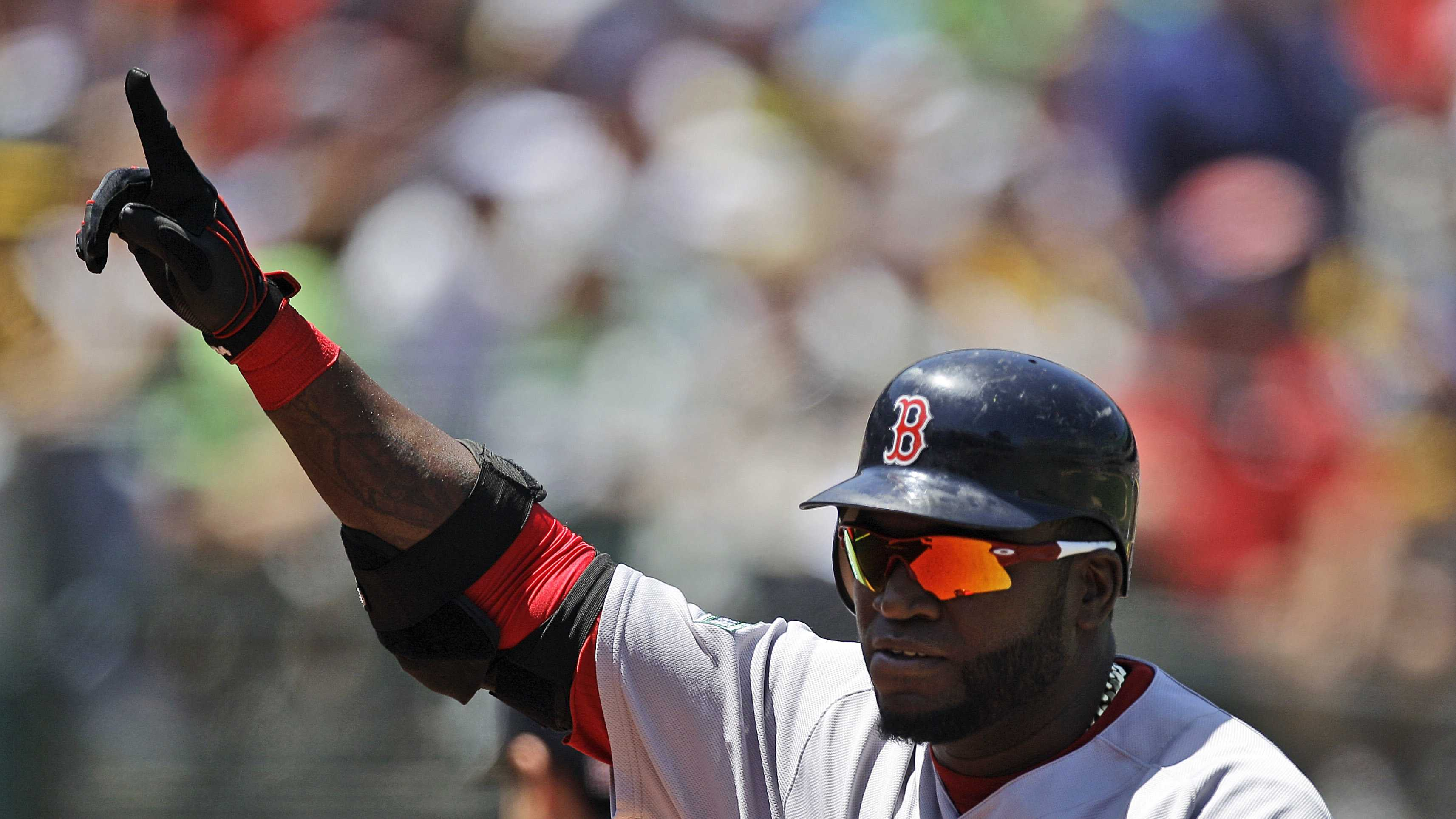 David Ortiz gestures after hitting his 400th career home run off Oakland Athletics' A.J. Griffin in the fourth inning, July 4, 2012.