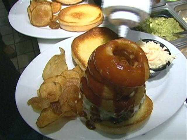 The Killer Bee is bacon, American cheese, beer battered onion rings, piled high and covered with honey barbecue sauce.