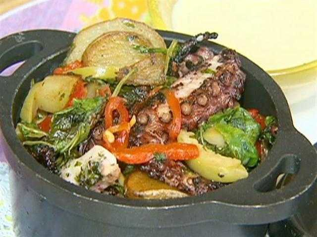For starters: an appetizer of grilled octopus with olives.