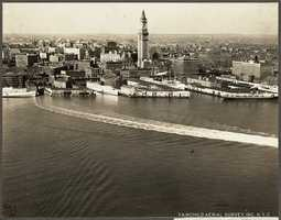 This is a view of the city skyline looking west from the harbor in a photograph taken in 1925.