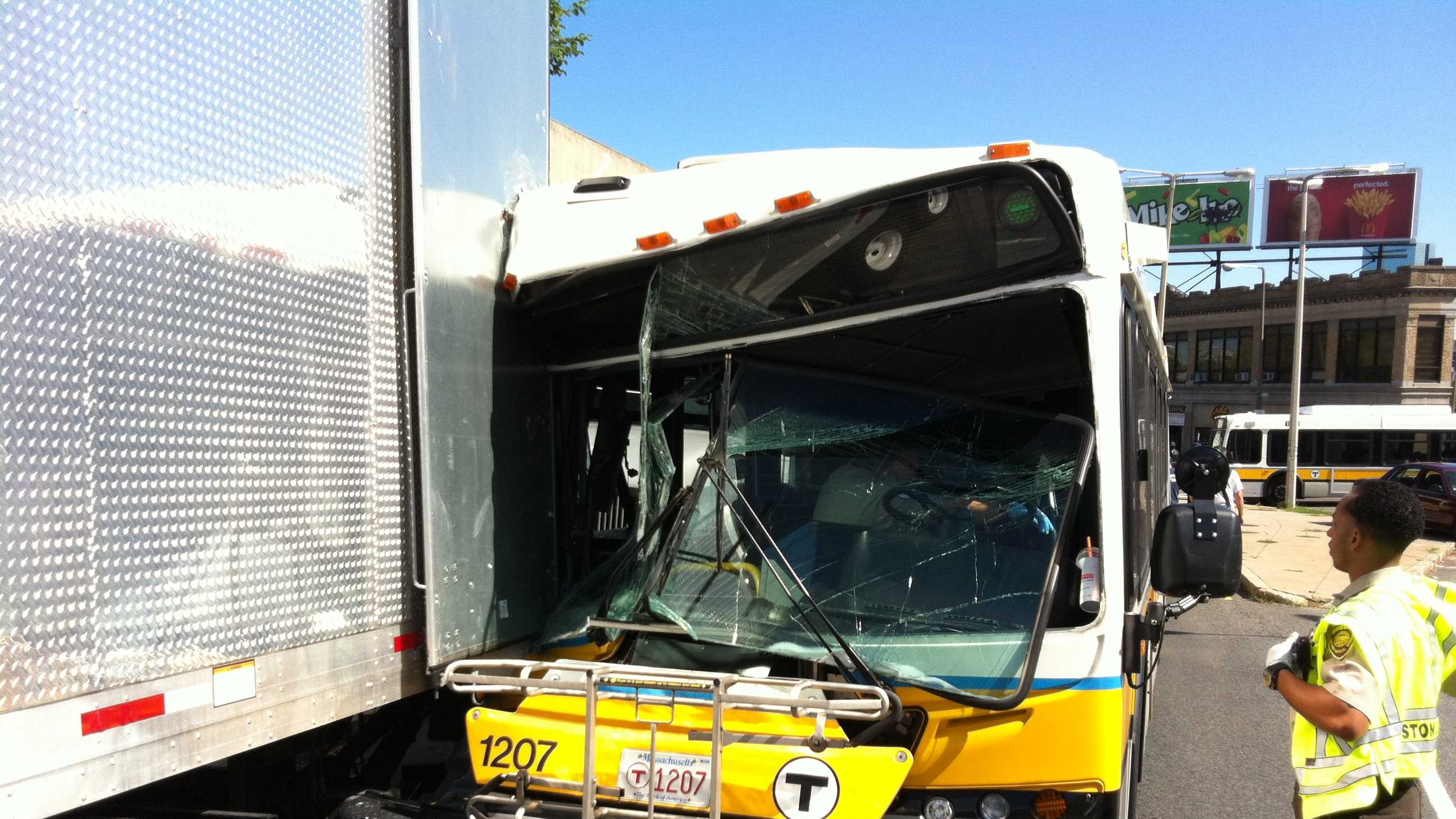Several people were injured Monday morning when an MBTA bus collided with a parked truck in Roxbury.