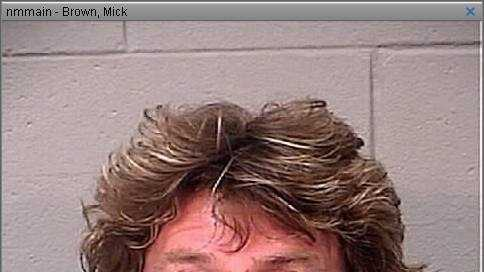 Mick Brown, the drummer for Ted Nugent's band, was arrested by Bangor, Maine  police and charged with Operating Under the Influence of Alcohol, Driving to Endanger, Theft and Assault.