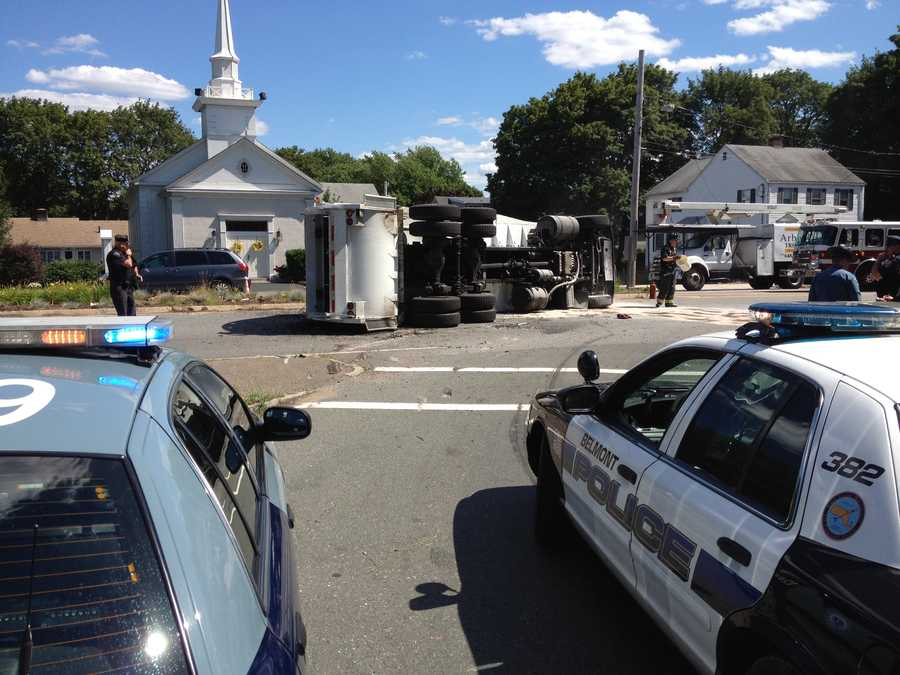 A trash truck rolled over in Belmont Monday afternoon.