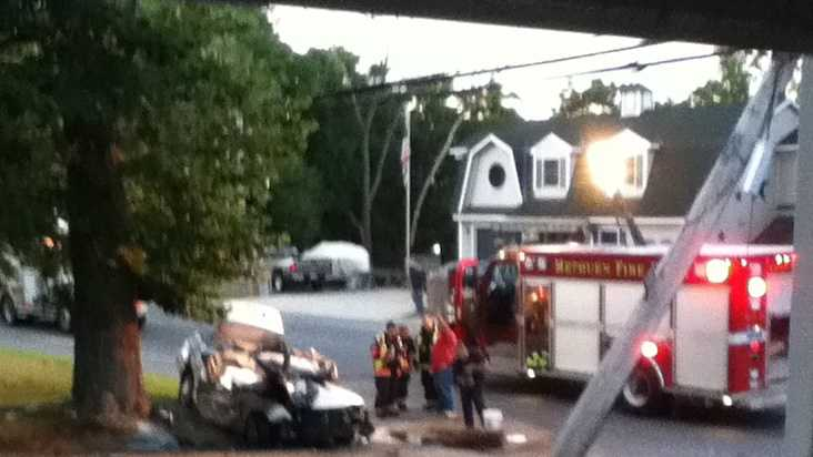 A Lawrence teenager driving a stolen vehicle has died after striking a utility pole and a tree in Methuen.