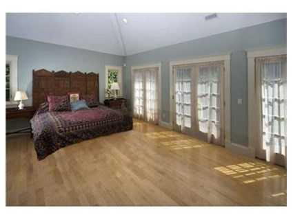 A 2-story master suite is just one of five bedrooms found throughout the home.