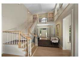 A dramatic two-story entry foyer leads into the $1.799 million residence.