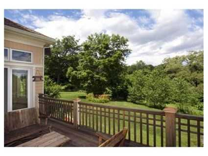 Built in 2000, the home includes a large, outdoor deck that looks out onto 1.1 acres of lush land.