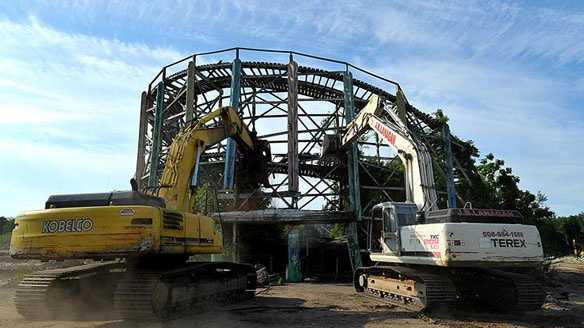 "A pair of excavators roll in for the kill as ""The Comet"" at Lincoln Park comes down after years of decay."