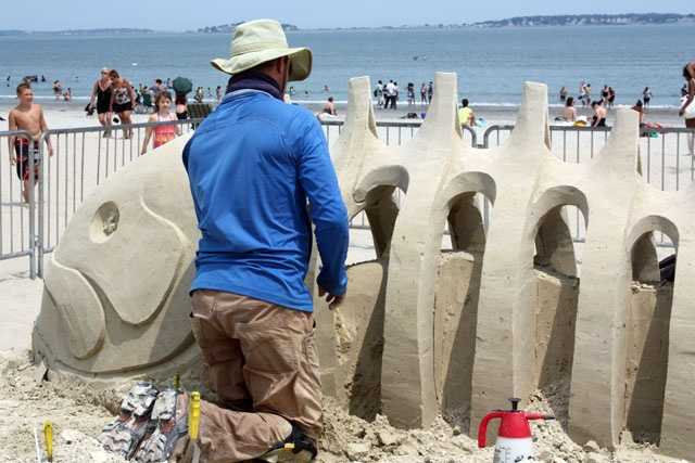 Stephane Robert from Montreal is seen working on his fish sculpture.