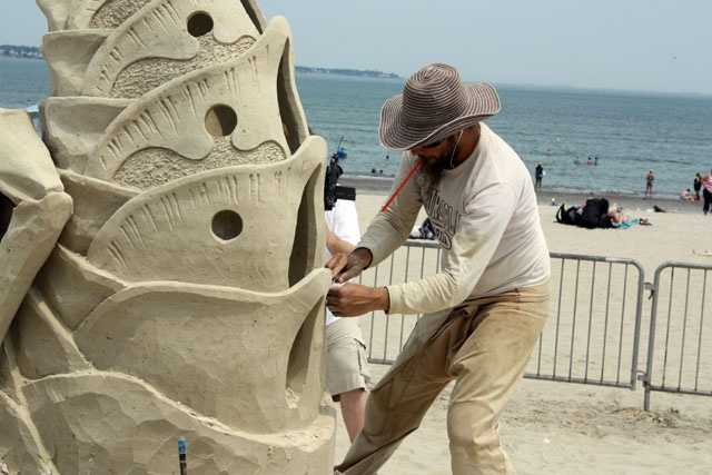 "He won first place in the 2012 competition for ""Bee or Not to Be,"" making him a third-time champion of the Revere Beach sand Sculpting Festival"