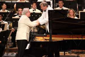 Emanuel Ax and Stephan Asbury shake hands after a performance of Haydn's Piano Concerto in D at the Tanglewood 75th Anniversary Gala.