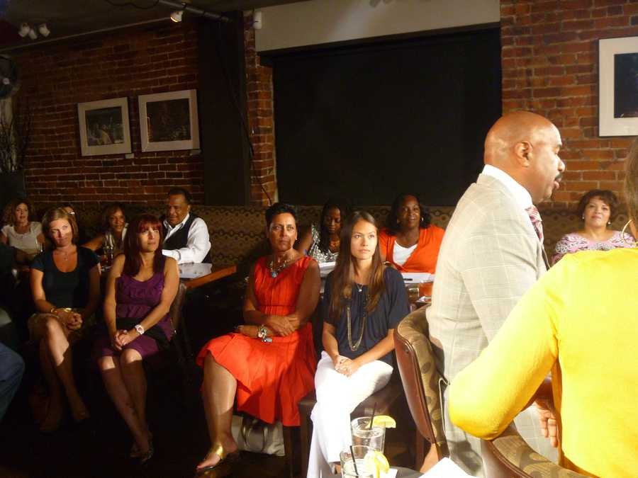 Audience members intently listening to Steve Harvey chat about life, family, relationships, and his busy schedule!