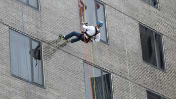 Chronicle's Anthony Everett and Storm Team 5's David Brown put on their harnesses Friday and rappelled down the side of the Hyatt to raise money for the Special Olympics of Massachusetts.