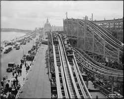 "The Derby Racer, pictured here in 1920, was one of two wooden ""racing"" roller coasters at Revere Beach. In its 25 years of operation, the coaster caused numerous deaths and injuries."