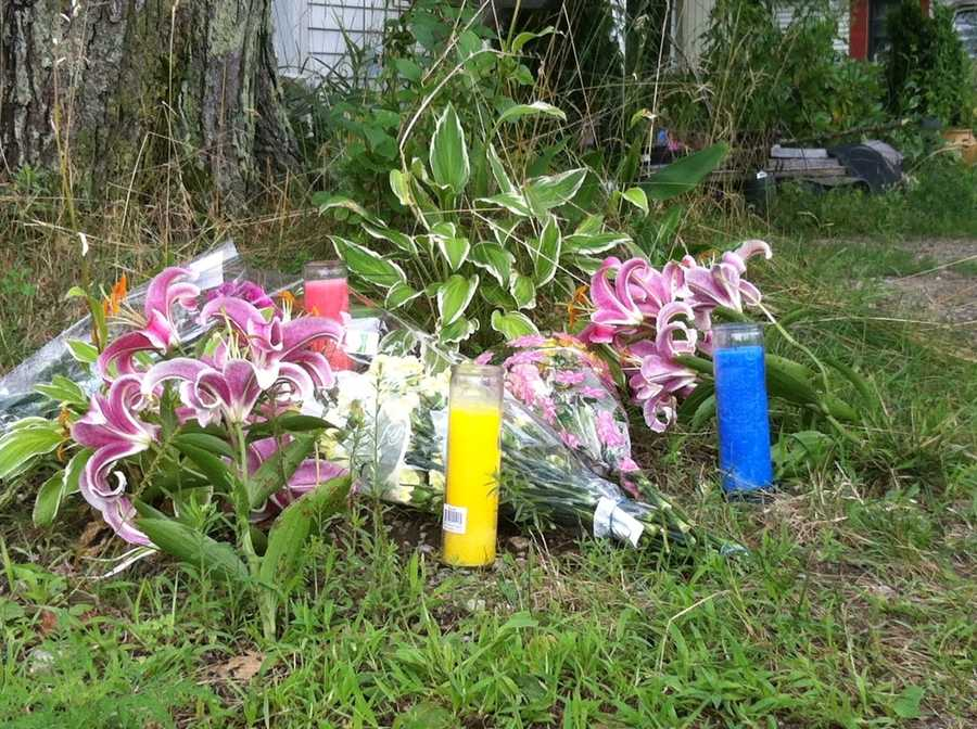 Family and friends placed flowers outside the home on Sunday.