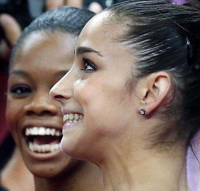 U.S. gymnasts Alexandra Raisman, right, and Gabrielle Douglas celebrate after qualifying for the women's all-around finals during the artistic gymnastics women's qualifications.