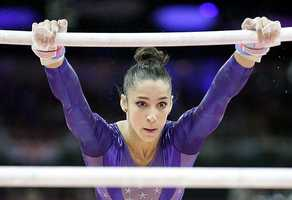 U.S. gymnast Alexandra Raisman performs on the uneven bars during the Artistic Gymnastics women's qualification.