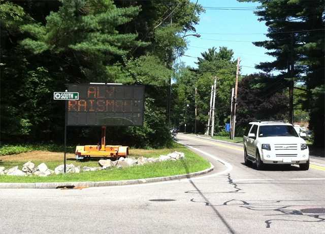 A sign at Dedham Avenue and South Street in Needham wishes Aly Raisman good luck.