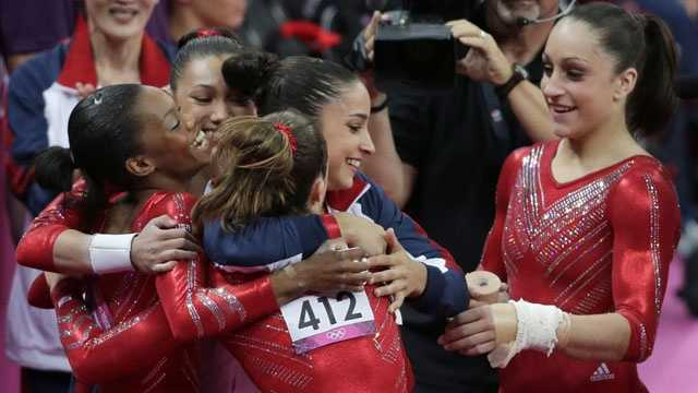 U.S. gymnasts celebrate after their routine on the vault during the Artistic Gymnastic women's team final at the 2012 Summer Olympics, Tuesday, July 31, 2012, in London.