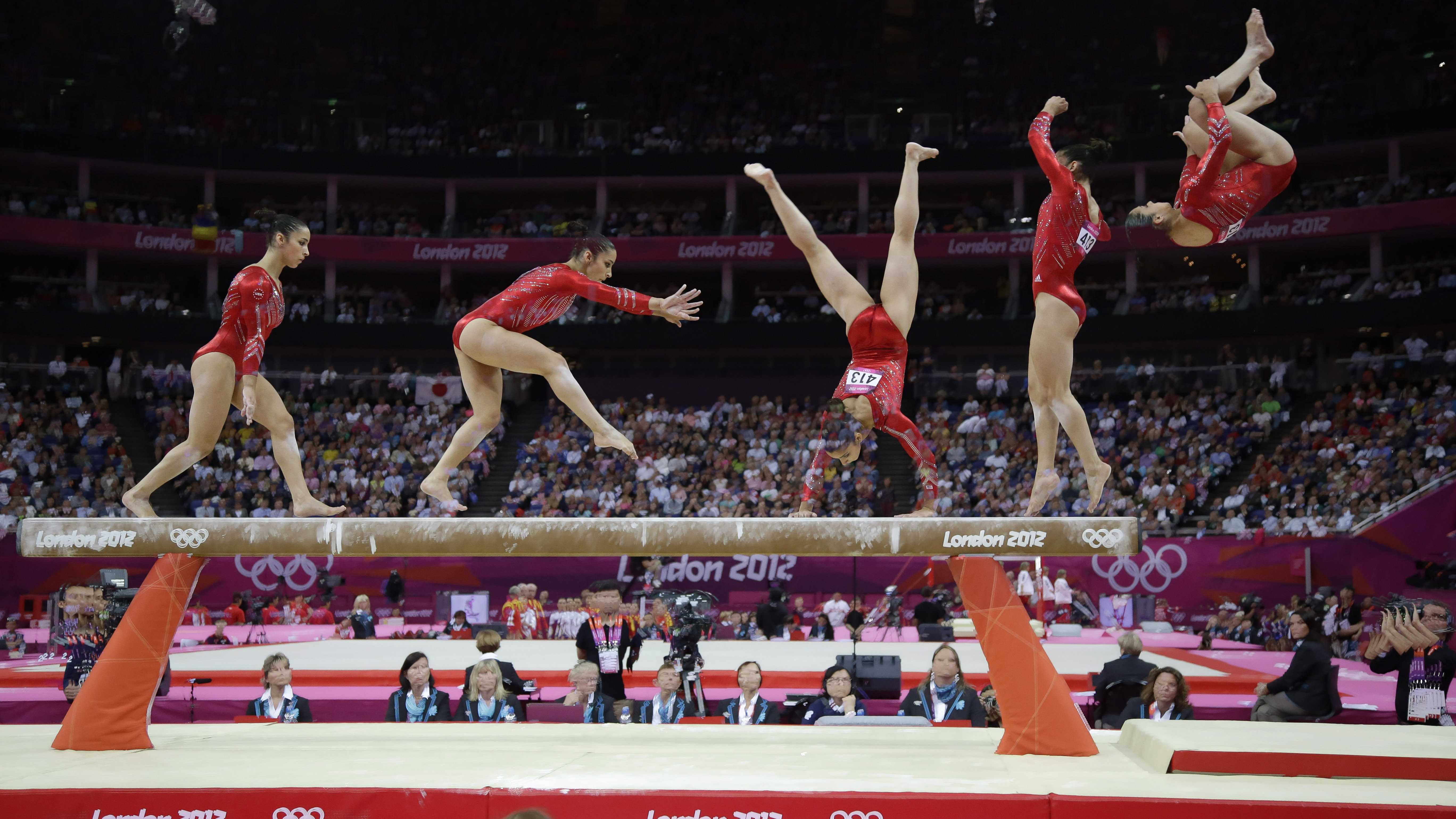 In this multiple exposure photo, U.S. gymnast Alexandra Raisman performs on the balance beam during the Artistic Gymnastics women's team final at the 2012 Summer Olympics, Tuesday, July 31, 2012, in London.