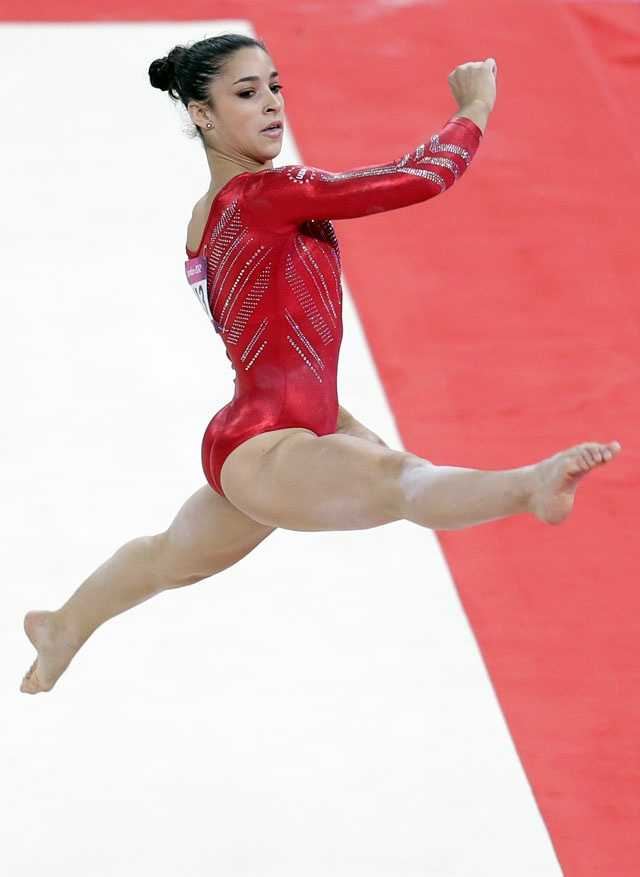 "Alexandra Raisman performs on the floor during the Artistic Gymnastic women's team final. She closed it out with a rollicking routine to ""Hava Nagila,"" soaring high on her tumbling passes and sticking a landing with a cement-like firmness."