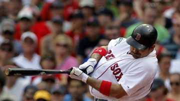 Boston Red Sox's Adrian Gonzalez hits an RBI-single off a pitch by Minnesota Twins' Nick Blackburn in the third inning of a baseball game at Fenway Park, in Boston, Sunday, Aug. 5, 2012.
