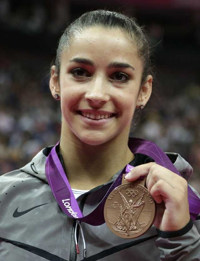 Bronze medallist for the balance beam Alexandra Raisman from the U.S. celebrates during the artistic gymnastics women's apparatus finals.